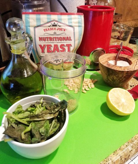 Simple ingredients for a vegan pesto sauce